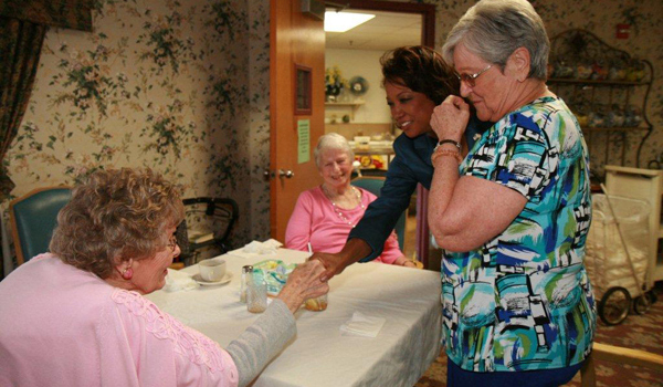 Jennifer visits with seniors at Advent Christian Retirement Center
