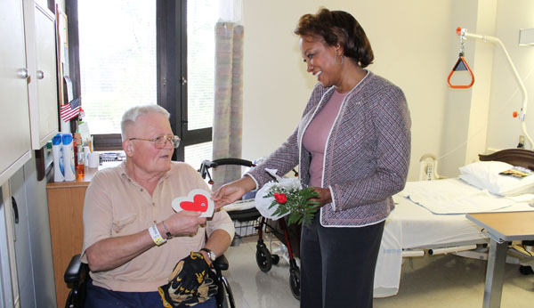 Jennifer gives Valentines gifts to Disabled Veterans at Lake City VA Hospital